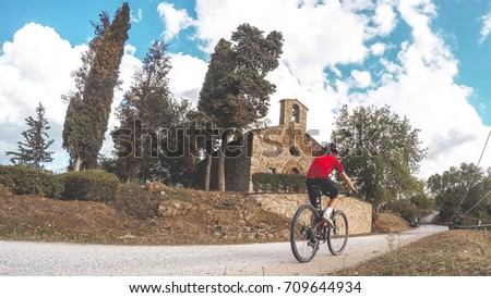 Cycling in Tuscany countryside.