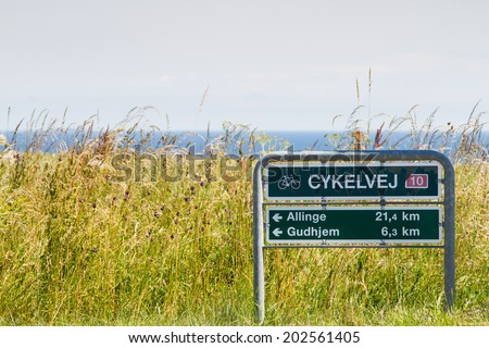 Cycling sign with direction, Bornholm, Denmark - stock photo