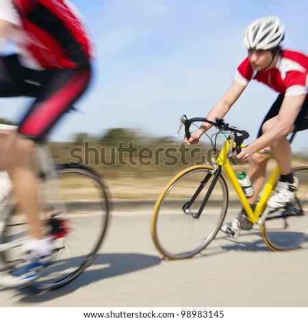 Cyclist at high speed in pursuit. Motion blur panned image - stock photo