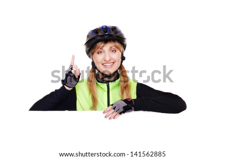 cyclist girl making the information  gesture holding the horizontal blank - stock photo