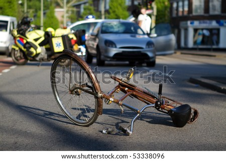 Cyclist hit by car. Paramedics and police on scene. - stock photo