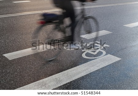 Cyclist in full speed after a heavy shower - Denmark. - stock photo
