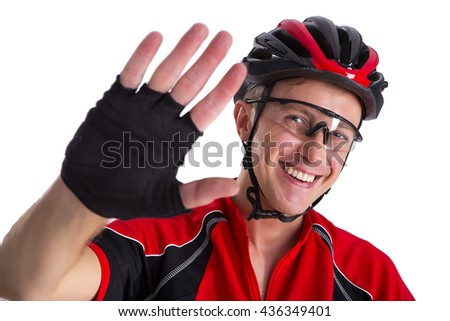 Cyclist man of Caucasian appearance. Welcomes the hand wearing a helmet. Studio photography. Isolated from the background. Horizontal shot. - stock photo