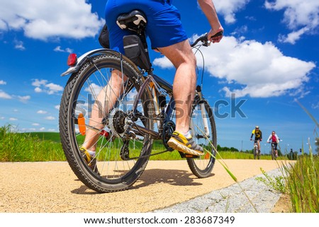 Cyclist on the bicycle road at sunny day, Poland - stock photo