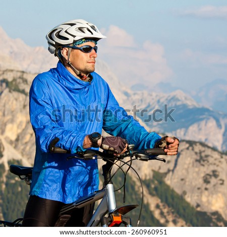Cyclist on the pass in Dolomites. Alps - stock photo
