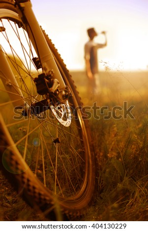 Cyclist relaxing; vertical