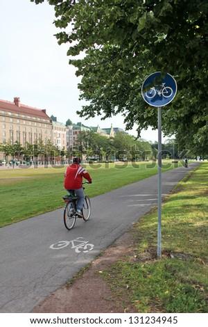cyclist rides along the bike path - stock photo