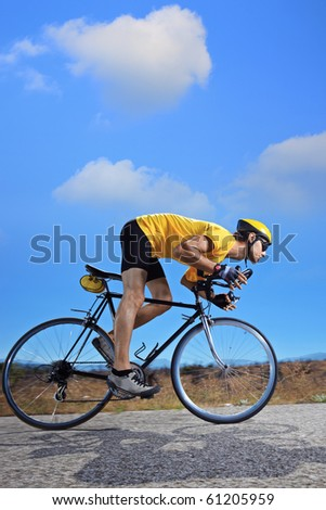 Cyclist riding a bike on an open road in Macedonia - stock photo