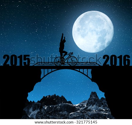 """Cyclist riding across the bridge in night. Forward to the New Year 2016. """"Elements of this image furnished by NASA"""". - stock photo"""
