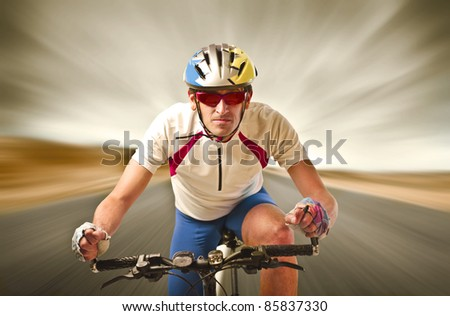 Cyclist riding fast - stock photo