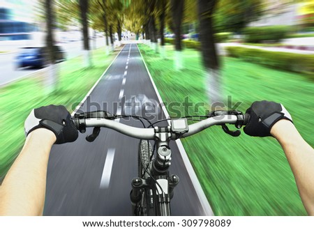 Cyclist riding on the bike path - stock photo