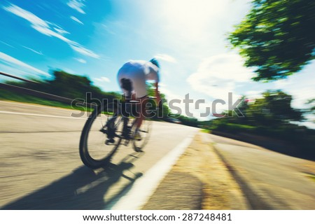 Cyclist speeding in a country road during a race for the victory