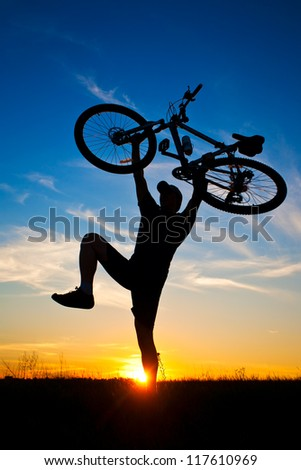 cyclist with a bike silhouette on a blue sky background