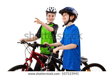 Cyclists - boy and girl isolated on white background - stock photo