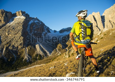 Cyclists in the Dolomites of South Tyrol - stock photo