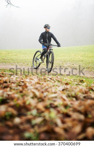 Cyclists preparing for off road training. Bad weather. - stock photo