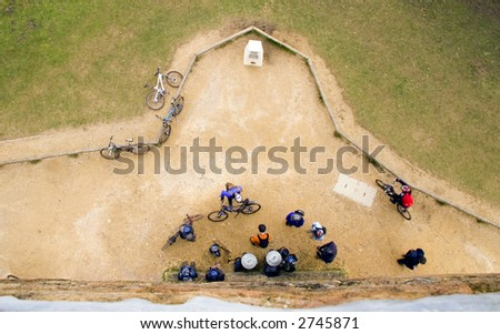 Cyclists stopped for a break, view from above - stock photo