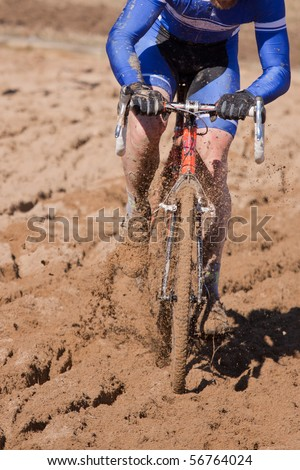 Cyclocross Racer in Sand Trap - stock photo