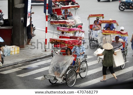 cyclomen and tourist in Hanoi's Old Quarrter on Aug 16, 2016. Cyclo is the tourist's favourite vehicle transportation in vietnam