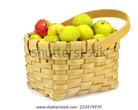 Cydonia or japanese quince fruit in basket on a white background