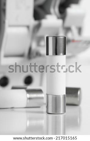 Cylinder Fuse with Fuse Holder Background - stock photo