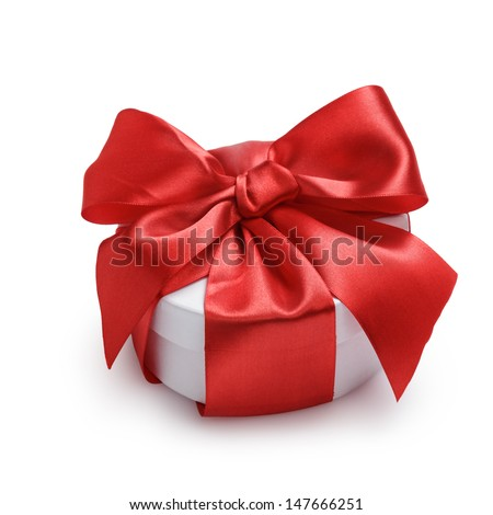 cylinder gift box with ornate ribbon bow, isolated on white - stock photo