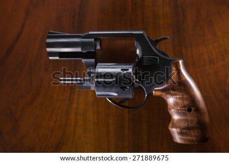 Cylinder revolver handgun over wooden background. - stock photo