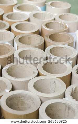 Cylinders cardboard background of Rolled paper in offset printing house, vertical