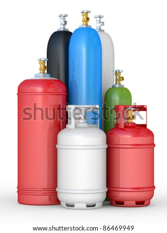 Cylinders with the compressed gases on a white background - stock photo