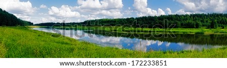 Cylindrical panorama of a tranquil landscape with the river, meadow and pine forest