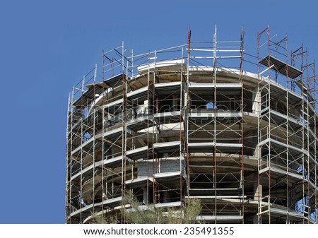 cylindrical shape building under construction - stock photo