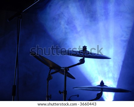 cymbals set in blue light of searchlights - stock photo