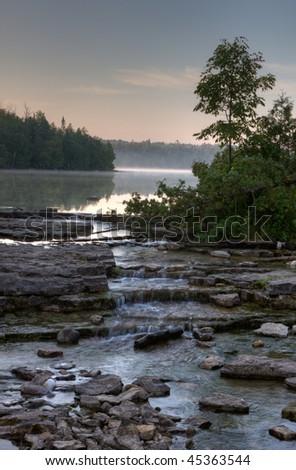 Cypress lake at dawn in Bruce Peninsula National park, Ontario, Canada. - stock photo