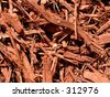 Cypress mulch in sun - stock photo