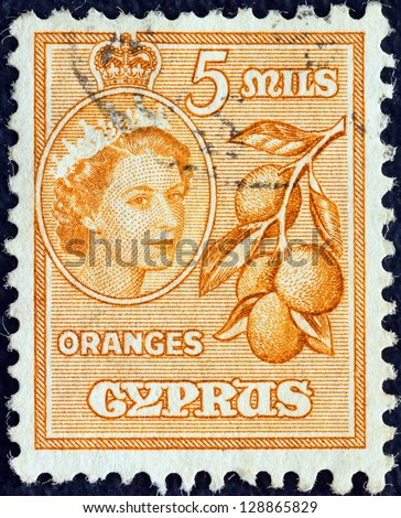 CYPRUS - CIRCA 1955: A stamp printed in Cyprus shows oranges and Queen Elizabeth II, circa 1955. - stock photo
