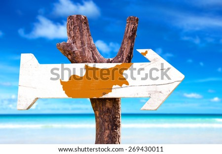 Cyprus Flag wooden sign with beach background - stock photo