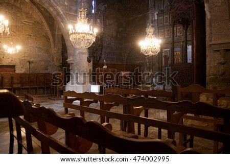 CYPRUS, KYRENIA - NOVEMBER 12, 2013: The interior of the old Greek Orthodox church in Bellapais Abbey in Northern Cyprus in Kyrenia (Girne).