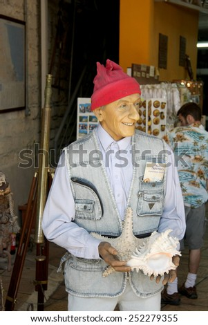 CYPRUS MAY 16 2009: The figure of Jacques  Cousteau  diver and the modern father of scuba diving gear stand in front of a local diver shop. Cousteau contributed all his life to underwater research.  - stock photo