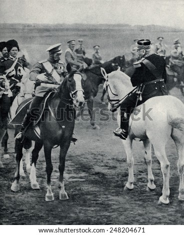 Czar Nicholas II and French General Joffre at joint maneuvers in August 1913. The Triple Entente allies threatened Germany with a two front war in the tense years before World War 1.