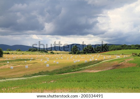 czech country with straw bales  - stock photo