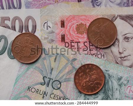 Czech korunas CZK (legal tender of the Czech Republic) banknotes and coins - stock photo