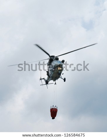 Czech military helicopter against a blue sky - stock photo