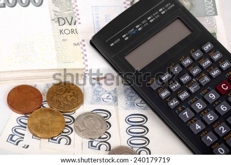 Czech money banknotes, coins and calculator, money concept - stock photo