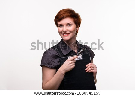 Czech/Prague/2/2018 A young beautiful red head lady portrait in front of a white background.