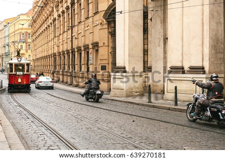 Czech Prague, December 24, 2016: Authentic and unusual city of Prague. On the roads go vintage trams and bikers on modern motorcycles.