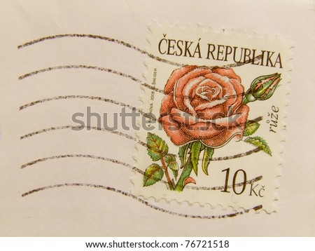 CZECH REPUBLIC - CIRCA 2009: A post stamp printed in Czech Republic and showing a red or pink rose (rosa rosa) flower, series, circa 2009. - stock photo