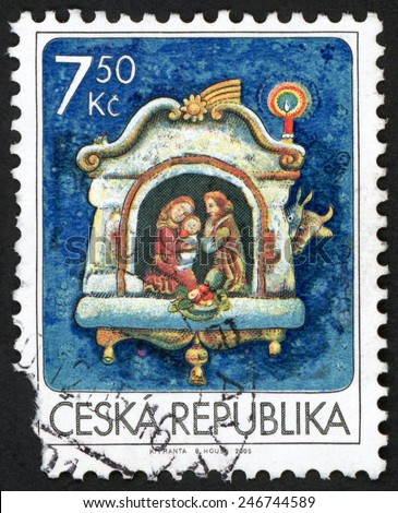 CZECH REPUBLIC - CIRCA 2005: Christmas stamp printed in Ceska (Czechoslovakia) shows Holy family nativity scene; birth of Jesus Christ at Bethlehem and animals; Scott 3290 A1279 7.50k blue, circa 2005 - stock photo