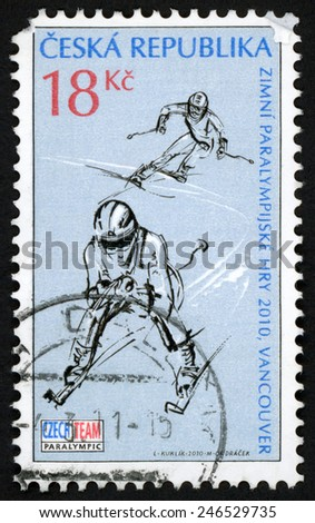 CZECH REPUBLIC - CIRCA 2010: post stamp printed in Ceska (Czechoslovakia) shows guided skiing; 2 skiers; Vancouver winter Paralympics games; Scott 3442 18k blue, circa 2010 - stock photo