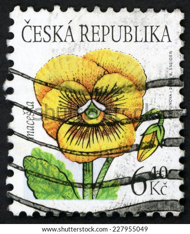 CZECH REPUBLIC - CIRCA 2002: post stamp printed in Czechoslovakia (Ceska) shows illustration of yellow pansy (maceska) flower on white background; Scott 3176 A1215 6.40k, circa 2002 - stock photo