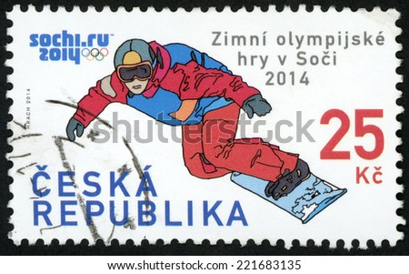 CZECH REPUBLIC - CIRCA 2014: post stamp printed in Czechoslovakia (Ceska) shows snowboarder; XXII. winter Olympic games in Sochi, Russia; 25k red blue, circa 2014 - stock photo
